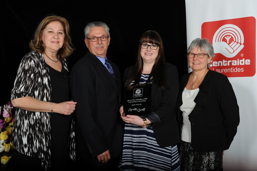 Doug and Donna Sharpe along with Megan Beaulieu and Suzanne Piché, General Manager of Centraide Laurentides.